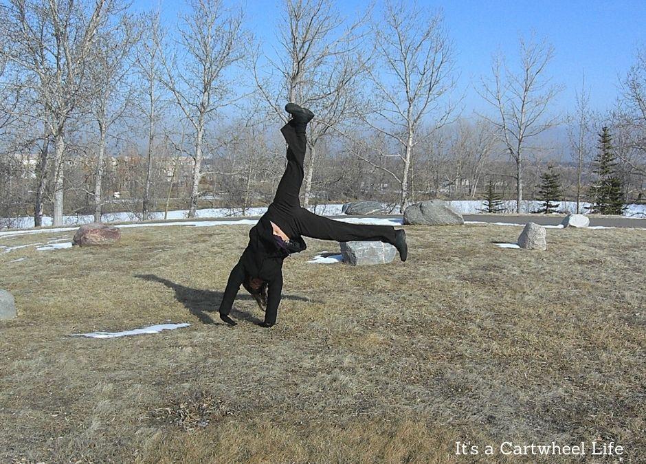 cartwheeling outside on university campus